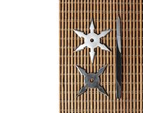Ninja Star Shurikens with throwing spikes on Wooden Background,. Closeup Ninja Star Shurikens with throwing spikes on Wooden Background, Copy Space stock photography