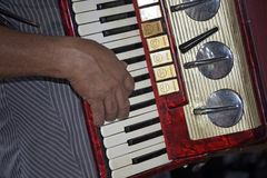 Closeup of Northeastern accordionist. Fingering the keys of his musical instrument. Sao Paulo, Brazil stock images