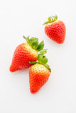 Closeup of not fully ripe strawberries. Over white background Royalty Free Stock Images