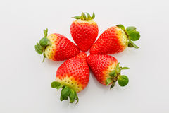 Closeup of not fully ripe strawberries. Over white background Royalty Free Stock Image