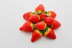 Closeup of not fully ripe strawberries. Over white background Stock Photography