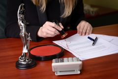 Closeup on notary hand stamping the document. royalty free stock photo