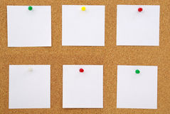 Closeup of note papers on cork board Stock Image