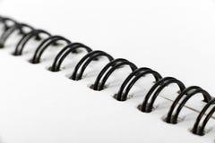 Closeup of notebook coil binding. Closeup of notebook coil binding shot in studio Stock Images
