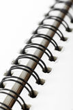Closeup of notebook coil binding Stock Images
