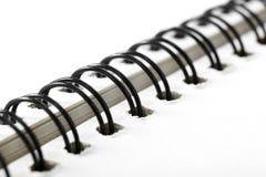 Closeup of notebook coil binding. Shot in studio Royalty Free Stock Photos