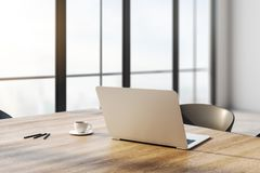 Closeup of notebook on desktop. Close up and side view of notebook and coffee cup on wooden desktop in office interior with panoramic city view and daylight stock illustration