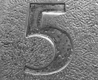 Closeup of the number five embossed in metal Stock Image