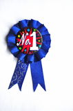 First Prize Blue Ribbon. Closeup of a number one blue ribbon Royalty Free Stock Photo
