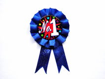 First Prize Blue Ribbon. Closeup of a number one blue ribbon Royalty Free Stock Photos
