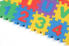 Closeup of Number puzzles. Multi colored Number puzzles on white background vector illustration