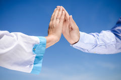 Closeup of nurse's hand touching someone's hand in Royalty Free Stock Image