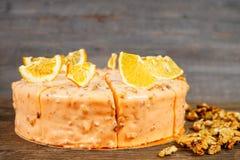 Nuts and orange cake Royalty Free Stock Image