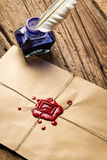 Closeup o blue ink inkwell on envelope with red sealant stock photo