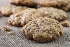 Closeup of oatmeal cookie on burlap napkin Stock Photos