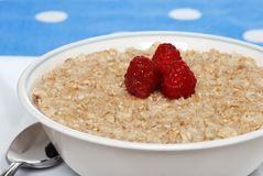 Closeup oatmeal with raspberries focus on berries Stock Photo