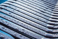 rain drops on metallic bench stock images