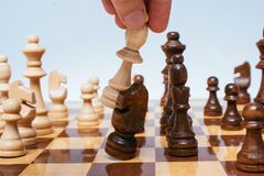 Free Closeup Of A Bishop Chess Piece Knocking Down The Knight On A Chessboard - Concept Of Leadership Stock Photo - 194087970