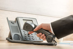 Free Closeup Of A Hand In A Formal Elegant Suit Dialing A Telephone N Royalty Free Stock Photography - 55382117