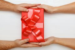 Free Closeup Of A Man Hand Giving A Red Box With A Gift To A Woman. Top View. Concept Of Valentine Day And Christmas Celebration Stock Image - 167448651