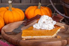 Closeup Of A Slice Of Pumpkin Pie With Whipped Cream Topping Royalty Free Stock Images