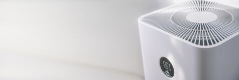 Free Closeup Of An Indoor Air Purifier In The Room Is Very Safe And Clean To Breathe While Dust Air Pollution Situation Outside Is Stock Photo - 182073370