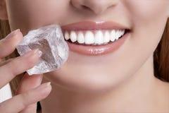 Free Closeup Of Beautiful Woman Biting An Ice Cube Royalty Free Stock Image - 68393706