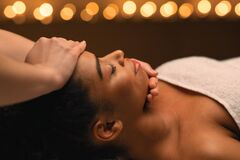 Free Closeup Of Black Girl Getting Smoothing Face Massage Royalty Free Stock Image - 185936536