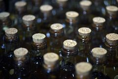 Free Closeup Of Bottlenecks Of Bottles Of Pinga Stock Photo - 118203440
