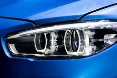 Free Closeup Of Car Headlight In Night. The Front Lights Of The Blue Royalty Free Stock Image - 99051036