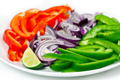 Closeup Of Chopped Peppers, Onion And Lime Royalty Free Stock Images
