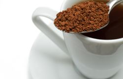 Closeup Of Coffee In Silver Spoon Royalty Free Stock Images