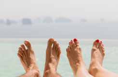 Free Closeup Of Couple Feet Over Sea And Sky On Beach Royalty Free Stock Photography - 53752947