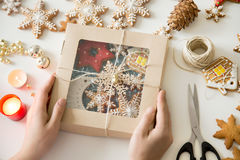 Closeup Of Hands Holding A Festive Box With Christmas Cookies Royalty Free Stock Photography