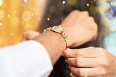 Free Closeup Of Hands, Sister Tying Rakhi, Raksha Bandhan To Brother`s Wrist During Festival Or Ceremony - Rakshabandhan Royalty Free Stock Photo - 191548095