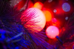Free Closeup Of Lit Up Red Christmas Tree Baubles. Stock Photo - 134794870