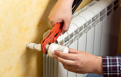 Free Closeup Of Man Installing Heating Radiator And Connecting Valve Stock Photography - 53499832