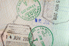 Closeup Of Several Stamps In A Passport Stock Photos