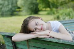 Free Closeup Of Teenage Girl Sitting, Relaxing In The Park, On A Bench. Education, School Girl. Smiling Young Woman. Summer Time, Stock Photos - 156078003