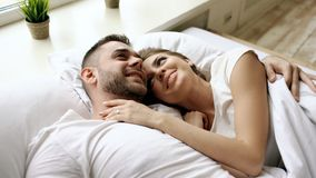 Free Closeup Of Young Beautiful And Loving Couple Talk And Hug Into Bed While Waking Up In The Morning. Stock Photos - 106335953