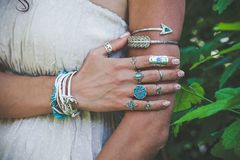 Free Closeup Of Young Woman Hand And Arm With Lot Of Boho Style Jewrly, Rings And Bracelets Outdoor Shot Stock Image - 117598381