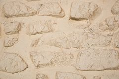Closeup off-white painted stone wall background texture. Closeup off-white painted old weathered stone wall background texture stock photo