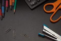 Closeup office stationery on black background Royalty Free Stock Photo
