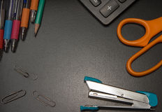 Closeup office stationery on black background Royalty Free Stock Image