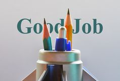 Text Good Job. Closeup of office stationery and text Good Job stock photo