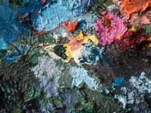 Closeup of oil color on palette of artist Stock Photos