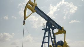Closeup of oil pumping equipment in work - stock video footage