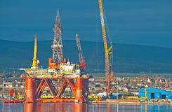 Closeup of oil rig at Invergorgordon. Closeup of oil rig in Cromarty Firth showing town of  Invergordon in background Royalty Free Stock Photography