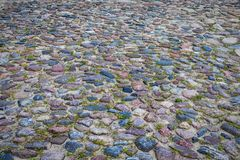 Closeup of Old Ancient Belarussian Pavement Made of Paving Stone Royalty Free Stock Photography