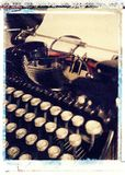 Closeup of old antique vintage black typewriter. With blank paper in roller Royalty Free Stock Images